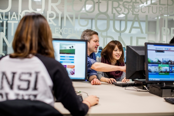 EC Melbourne students in the computer room with a teacher at the Centre. 3